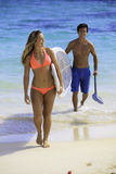 Couple with their paddle board royalty free stock photo