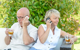 Couple with their phones are disgruntled Royalty Free Stock Photo