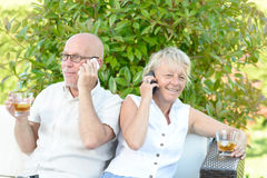 Couple with their phones Royalty Free Stock Images