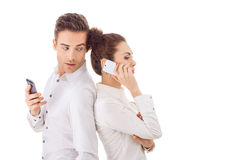 Couple With Their Phones Royalty Free Stock Photography