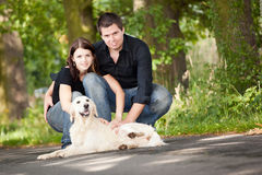 Couple With Their Puppy Stock Photo