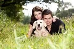 Couple With Their Puppy Royalty Free Stock Photos