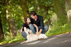 Couple With Their Puppy Stock Photography