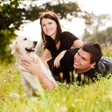 Couple With Their Puppy Stock Image