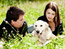 Couple With Their Puppy Stock Photos