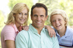 Couple And Their Son. Couple And Their Teenage Son Royalty Free Stock Image