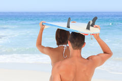 Couple with their surfboard Stock Image