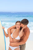 Couple with their surfboard Stock Photos