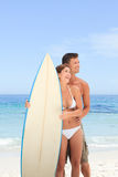 Couple with their surfboard Royalty Free Stock Images