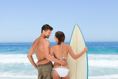 Couple with their surfboard Stock Images