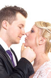 A couple on their wedding. Day kissing and laughing royalty free stock photography