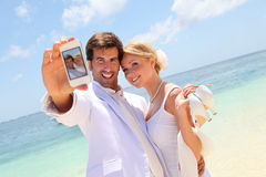 Couple on their wedding day. Just married couple taking picture of themselves Royalty Free Stock Image