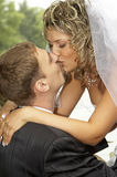 Couple on their wedding day. Kissing Royalty Free Stock Image