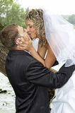 Couple on their wedding day. Kissing Stock Images