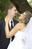 Couple on their wedding day. Kissing Stock Photos