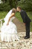 A couple on their wedding day. Kissing Stock Photos