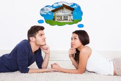 Couple thinking of dream house Stock Photos