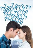Couple thinking with question marks stock image