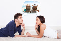 Couple Thinking Of Spending Vacation On Beach Royalty Free Stock Photography