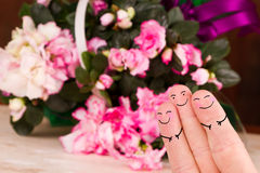 Couple of three. Concept of a valentine threesome with a flower background Royalty Free Stock Image