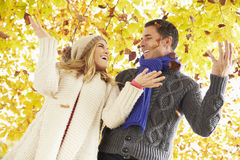 Couple Throwing Leaves In Autumn Garden Royalty Free Stock Image