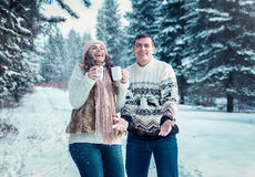 Couple throwing snow in winter forest Royalty Free Stock Images