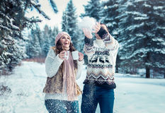 Couple throwing snow in winter forest Royalty Free Stock Photography