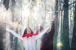 Couple throwing snow in winter forest Stock Photography