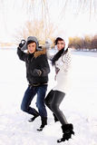 Couple throwing snowballs Royalty Free Stock Image