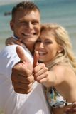 Couple with thumbs-up Royalty Free Stock Photography