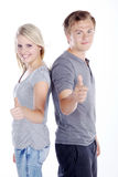 Couple with thumbs up. Beautiful couple with thumbs up Stock Photography