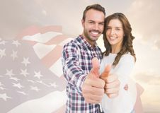 Couple thumbs up for independence day Royalty Free Stock Photos
