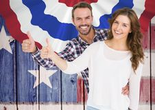 Couple thumbs up for independence day Stock Image