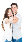 Couple with thumbs up Royalty Free Stock Images