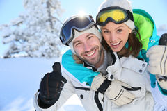 Couple with thumbs up for winter holidays royalty free stock image
