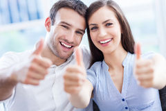 Couple with thumbs up. Young couple with thumbs up Royalty Free Stock Photography