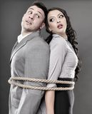 Couple tied with a rope Royalty Free Stock Photo