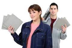 Couple with tile cutter Royalty Free Stock Images