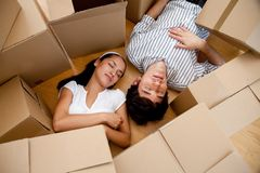 Couple tired of packing Royalty Free Stock Photos