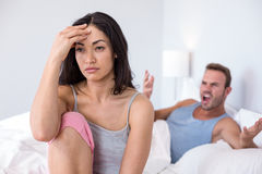 Couple in to argument on bed Royalty Free Stock Photo