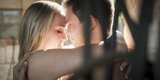 Couple about to kiss feeling temptation. Royalty Free Stock Image