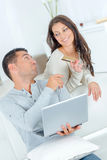 Couple about to place order on-line Stock Photo