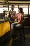 Couple toasting at bar. Stock Images
