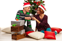 Couple toasting and celebrate Christmas Stock Photography