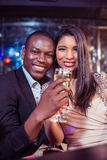 Couple toasting with champagne. In a club Royalty Free Stock Image