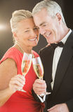 Couple Toasting Champagne Flutes Stock Image