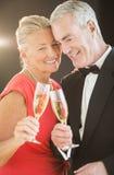 Couple Toasting Champagne Flutes Stock Image