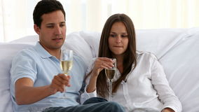 Couple toasting with champagne. In the living room in a new home stock video