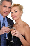 Couple toasting with champagne. Stock Photos