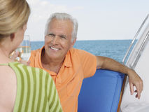 Couple Toasting Champagne On Yacht Stock Photo